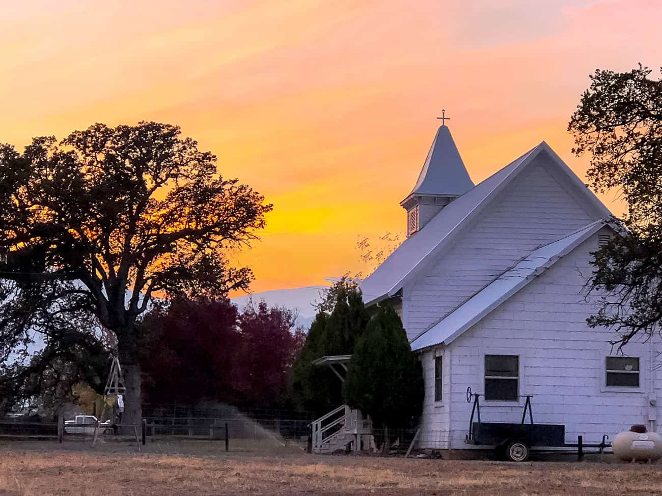 A country church at sunset