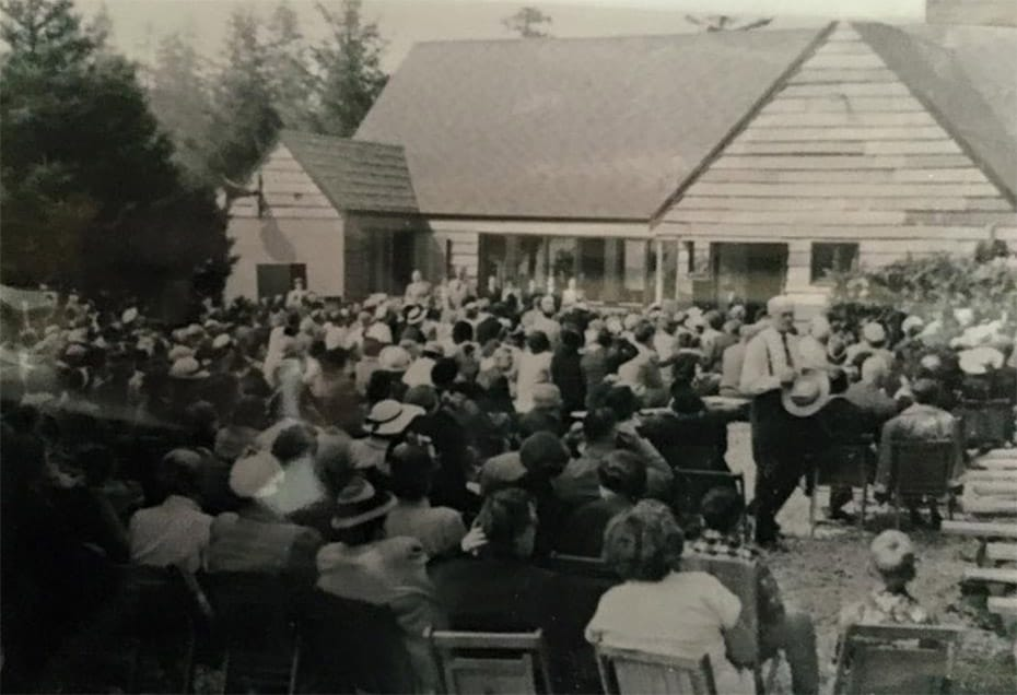A group of people at an early Village Missions church dedication