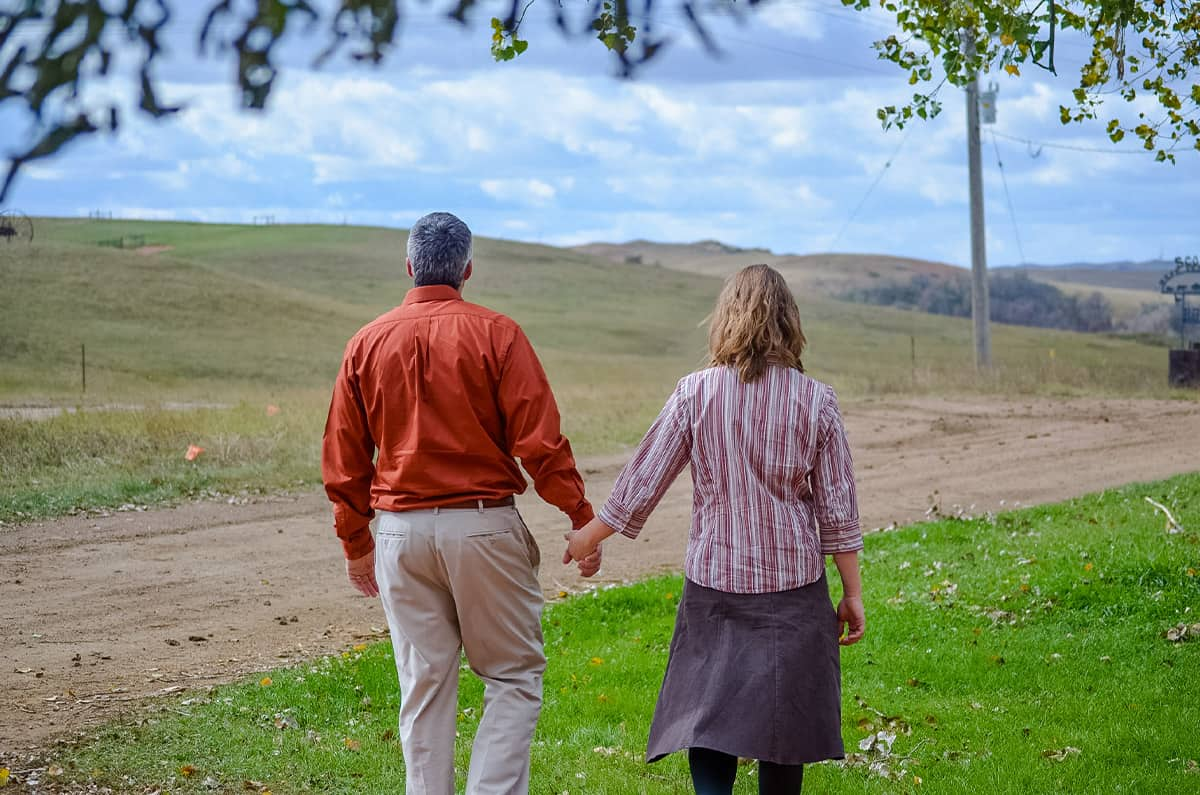 A rural pastor and his wife enjoy the countryside.