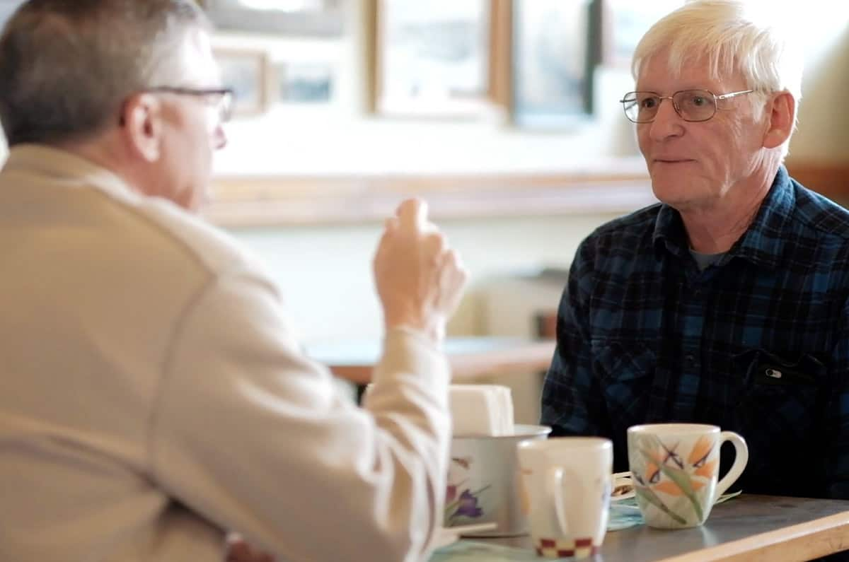 small town pastor meets with community member
